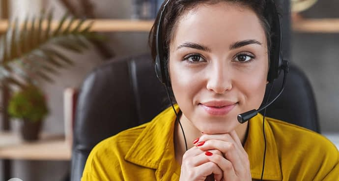 Friendly woman customer support, consultant or call service operator looking at camera